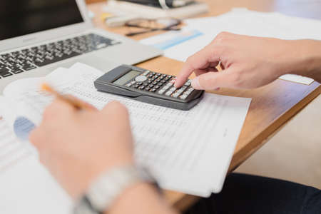 businessman using calculator for calculate budget accountancy, business data. finance and accounting concept Banque d'images