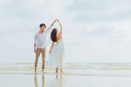 romantic time loving couple dance on the beach. Love travel concept. Honeymoon concept.