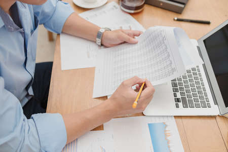 businessman working data document report marketing research, development planning, management strategy, analysis financial accounting. finance and accounting concept