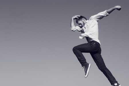 Young man jumping. Monochrome. art. Stock Photo
