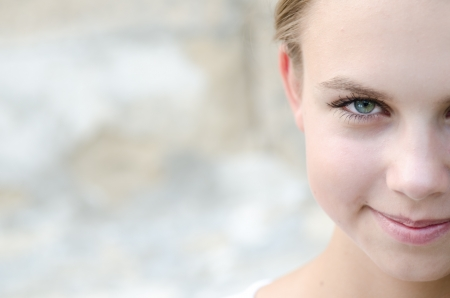Portrait of half face beautiful young woman.Outdoor. photo