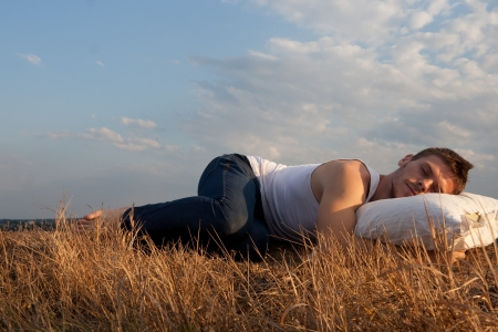 Man sleeping on field, rest concept.