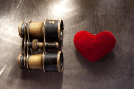 Concept Find Love  Old binoculars and heart  Stock Photo