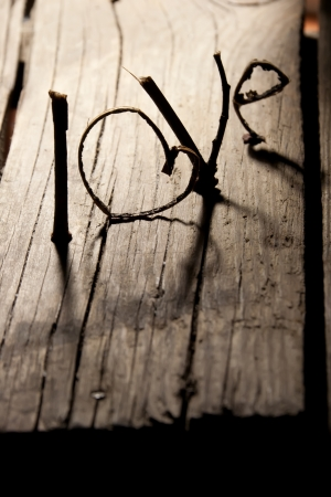 Word love on a old wood planks.