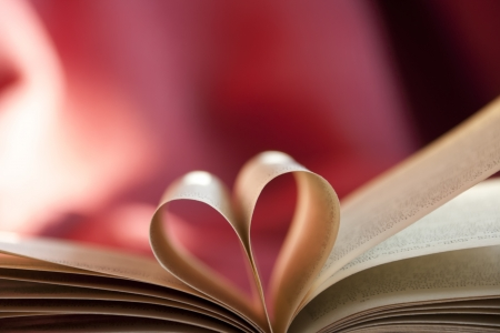 Pages of a book curved into a heart shape.