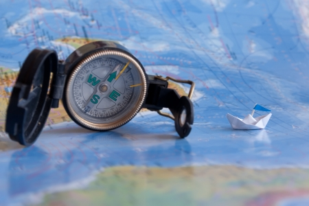 Map, compass and paper boat. Cruise concept. Stock Photo
