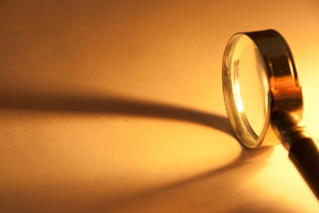 Close Up of magnifying glass with beam of light. Stock Photo