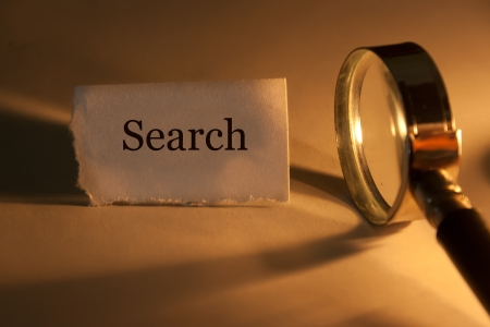 zoom in: Search concept, magnifying glass and the inscription search.