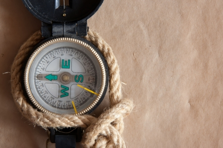 Old compass and rope on old paper background. photo