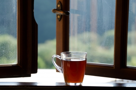 Cap Of Tea On Windowsill.
