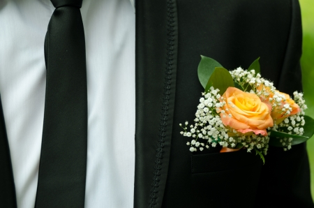 breast pocket: Yellow rose in breast pocket of a groom.