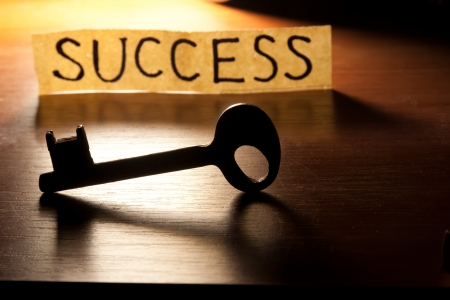 The Key to Success. Key on a wooden background. Stock Photo