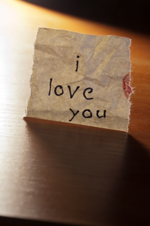 love message:  I love you an inscription  on a paper