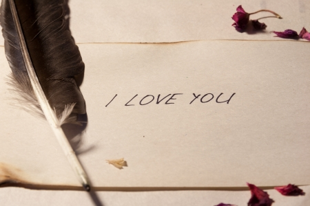 I love you. Inscription on the old paper.