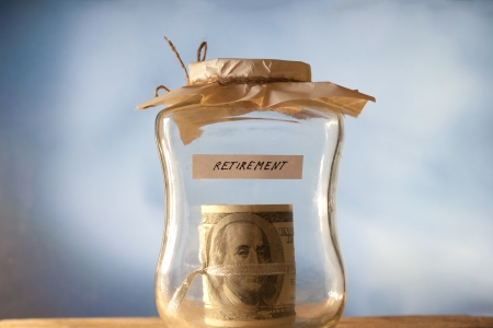 A jar of cash on the table. Retirement. photo