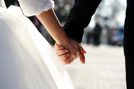 wedding theme, holding hands newlyweds photo