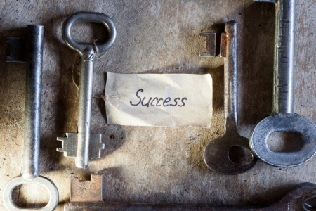 Key to success. Key with a success tag.