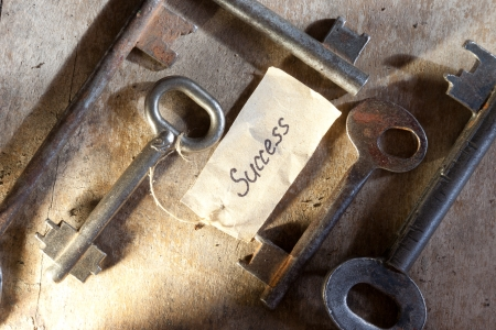 Key to success. Key with a success tag. photo