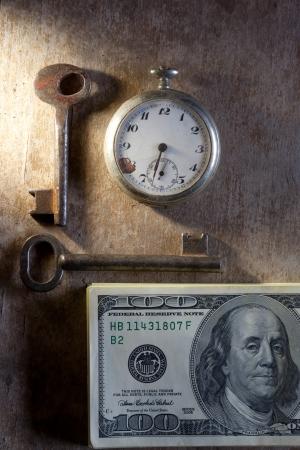 Key to Financial Success. Money, keys, pocket watch. photo