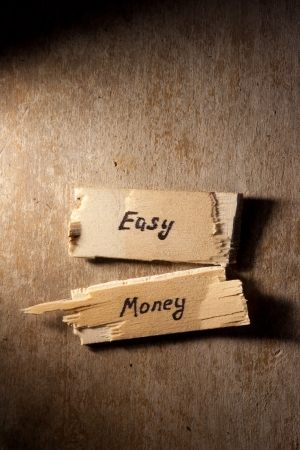 easy money: easy money concept, wooden surface Stock Photo
