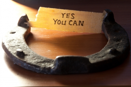yes you can  inscription and  horseshoe over wooden background Stock fotó