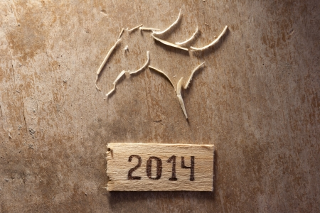 head tag: horses head and tag 2014 on an old wooden surface Stock Photo