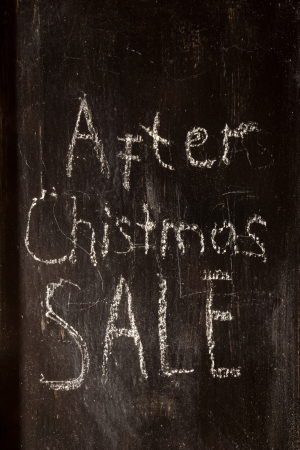 After Christmas Sale written in white chalk on a black chalkboard  photo