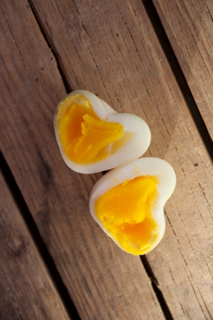 Heart Shaped Eggs on a old wooden table. photo
