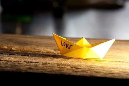 love concept. Paper boat and inscription love Stock fotó