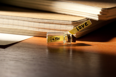Love - is i and you. Message in a Bottle. Love concept. photo