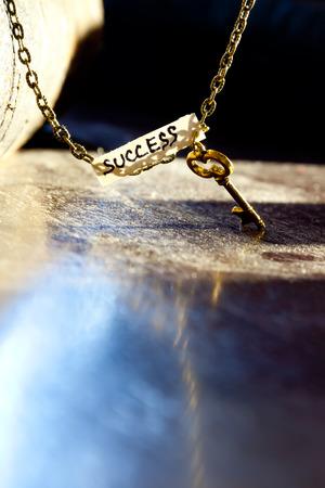 Golden key to success Stock Photo