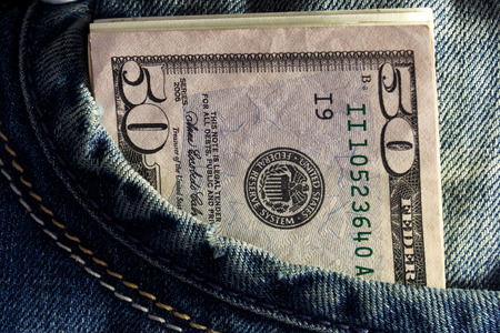 US dollar in the Jeans Pocket Stock Photo