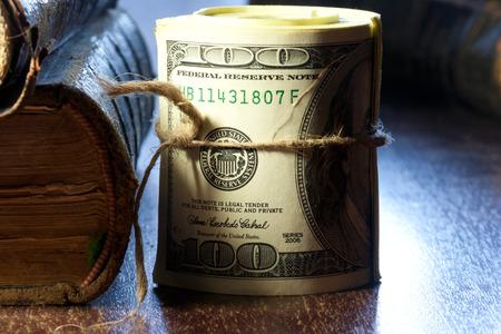 Rolled $100 dollar bills photo