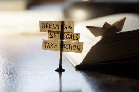 Dream Big, Set Goals, Take Action, concept, tags on the table. Reklamní fotografie