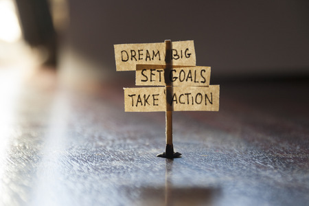 Dream Big, Set Goals, Take Action, concept, tags on the table. Stock Photo