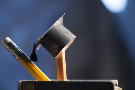 academics: pencils and graduation hat, education concept Stock Photo