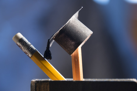 pencils and graduation hat, education concept Stock Photo