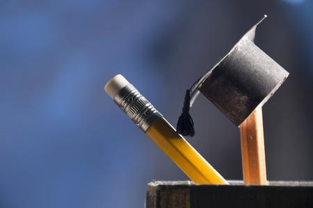 pencils and graduation hat, education concept Stockfoto
