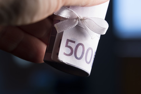 five hundred euro banknote with white bow