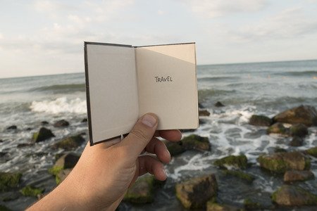 Travel - Inscription on the Book. Travel Concept. Ocean background.