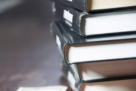 idea symbol: pile of books and money