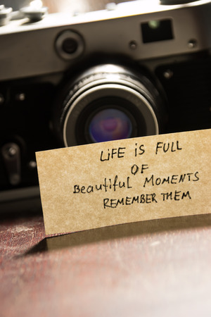 photo camera and quote life is full of beautiful moments - remember them