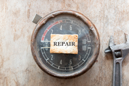 manometer: Repair concept. Steampunk background. Metal, mechanical device. Manometer.