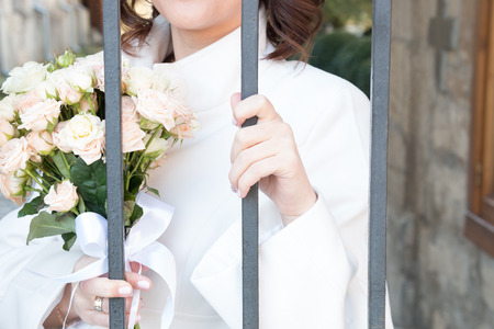 gaol: bride with flowers behind bars