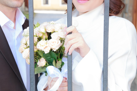 gaol: bride with flowers and groom behind bars