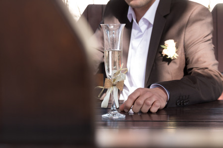 bridegroom: groom - bridegroom  with a glass champagne or sparkling wine