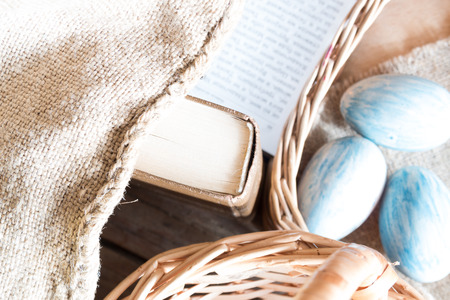 holiday prayer book: Easter background: book, basket and eggs.