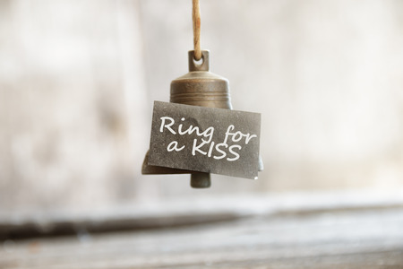 peal: ring for a kiss concept, the bell and the inscription