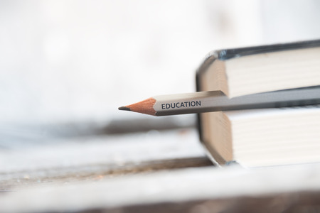 Education - the inscription on the pencil and book, book on desk, education concept. Reklamní fotografie