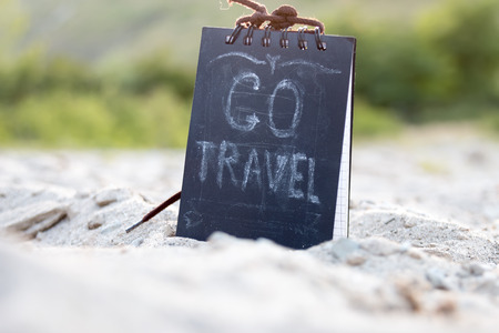 Go Travel - chalk lettering, sign on the beach. Stock Photo